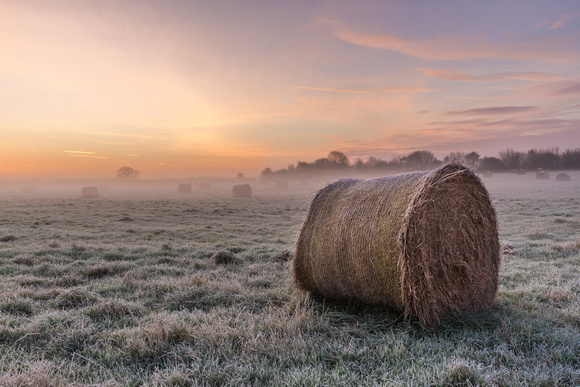 Haybale in the dawn mist at Botley